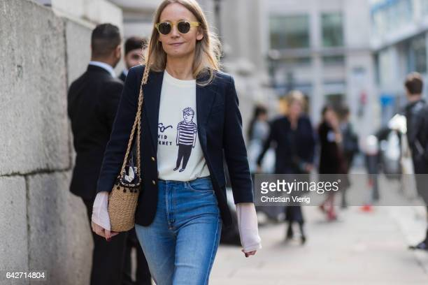 A guest wearing a blazer white knit straw bag outside Julien Macdonald on day 2 of the London Fashion Week February 2017 collections on February 18...