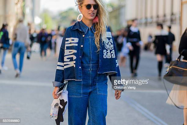 A guest wearing a blue denim jumpsuit and jacket at MercedesBenz Fashion Week Resort 17 Collections at Carriageworks on May 19 2016 in Sydney...