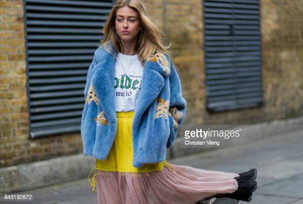 A guest wearing a blue fake fur jacket maxi skirt outside Mulberry on day 3 of the London Fashion Week February 2017 collections on February 19 2017...