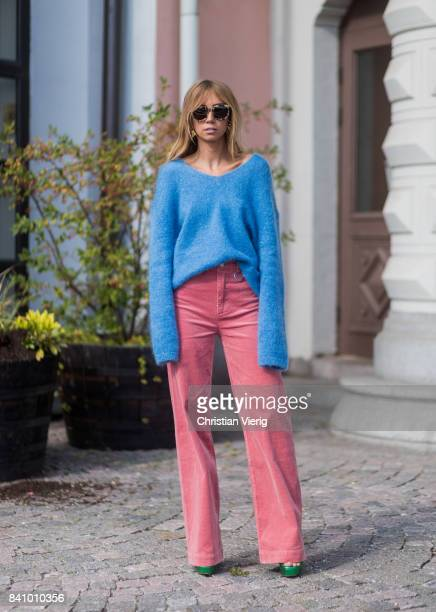 A guest wearing a blue knit red pants outside Stylein on August 30 2017 in Stockholm Sweden