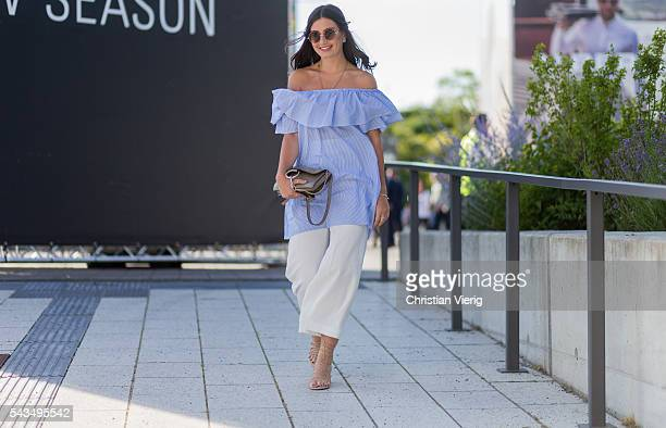 A guest wearing a blue off shoulder top and Chloe bag outside Marc Cain during the MercedesBenz Fashion Week Berlin Spring/Summer 2017 on June 28...
