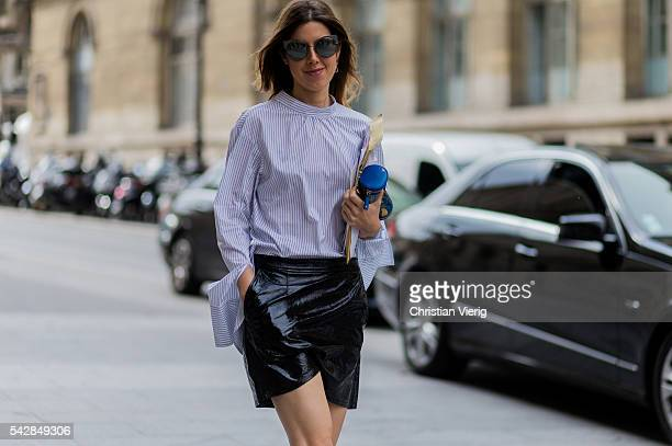 A guest wearing a blue white striped shirt and black leather skirt outside Maison Margiela during the Paris Fashion Week Menswear Spring/Summer 2017...