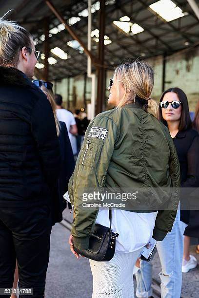 A guest wearing a bomber jacket arrives at the By Johnny show at MercedesBenz Fashion Week Resort 17 Collections at Carriageworks on May 17 2016 in...