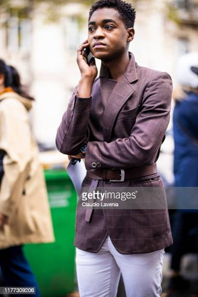 A guest wearing a brown checked blazer is seen outside the Faith Connexion show during Paris Fashion Week Womenswear Spring Summer 2020 on September...