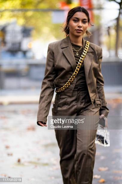 A guest wearing a brown striped suit is seen outside the Faith Connexion show during Paris Fashion Week Womenswear Spring Summer 2020 on September 24...