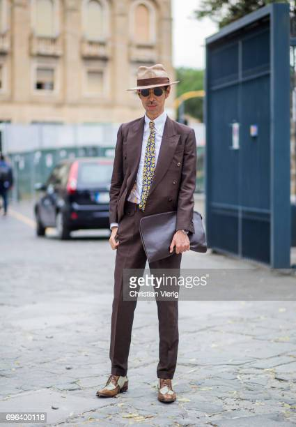 A guest wearing a brown suit is seen during Pitti Immagine Uomo 92 at Fortezza Da Basso on June 15 2017 in Florence Italy