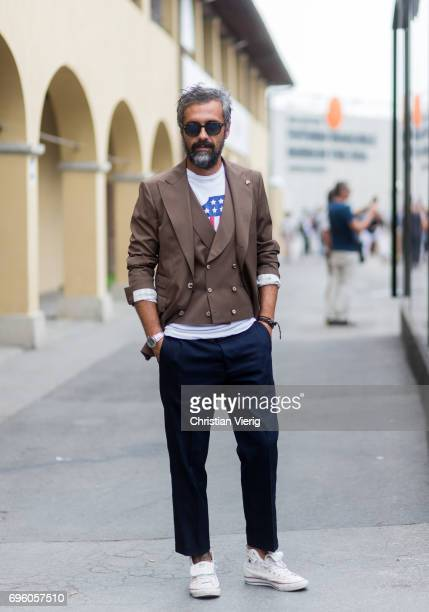Guest wearing a brown vest, blazer is seen during Pitti Immagine Uomo 92. At Fortezza Da Basso on June 14, 2017 in Florence, Italy.
