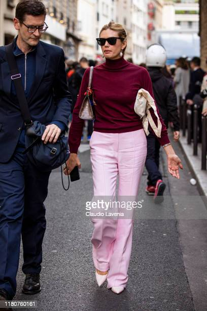 Guest, wearing a burgundy sweater, pink pants and pink heels, is seen outside the APC show during Paris Fashion Week - Womenswear Spring Summer 2020...