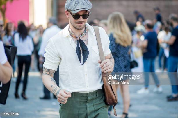 A guest wearing a button shirt flat cap scarf is seen during Pitti Immagine Uomo 92 at Fortezza Da Basso on June 13 2017 in Florence Italy