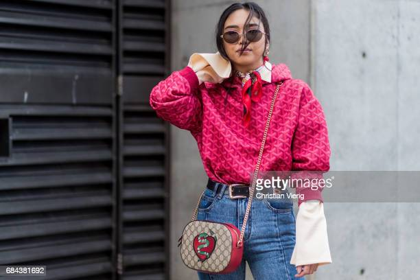 A guest wearing a button shirt with wide sleeves Gucci bag at day 5 during MercedesBenz Fashion Week Resort 18 Collections at Carriageworks on May 18...