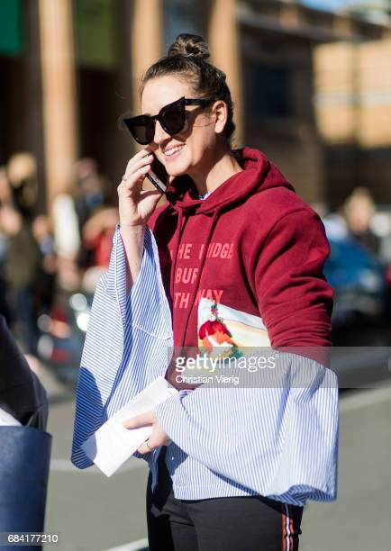 A guest wearing a button shirt with wide sleeves Vetements hoody outside Ginger Smart at day 4 during MercedesBenz Fashion Week Resort 18 Collections...