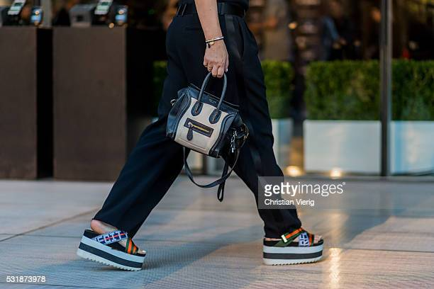 A guest wearing a Celine bag and platform sandals at MercedesBenz Fashion Week Resort 17 Collections at Carriageworks on May 17 2016 in Sydney...