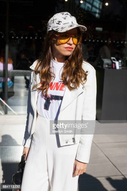 Guest wearing a Chanel cap and orange glasses during MercedesBenz Fashion Week Resort 18 Collections at Carriageworks on May 17 2017 in Sydney...