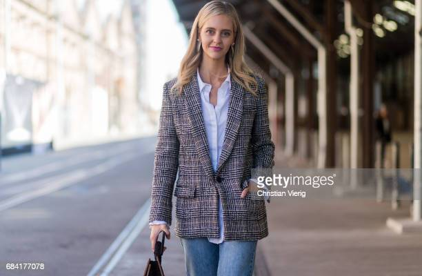A guest wearing a checked blazer denim jeans silver boots at day 4 during MercedesBenz Fashion Week Resort 18 Collections at Carriageworks on May 17...