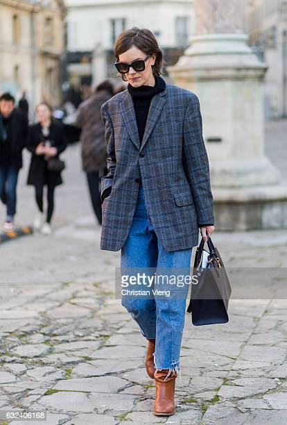 A guest wearing a checked blazer outside Paul Smith on January 22 2017 in Paris France