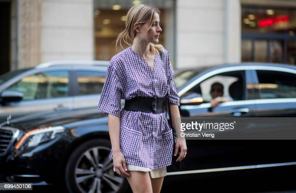 A guest wearing a checked button dress with corset outside Haider Ackermann during Paris Fashion Week Menswear Spring/Summer 2018 on June 21 2017 in...