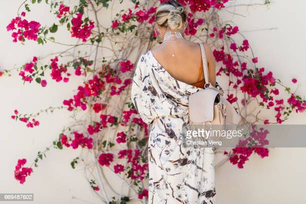A guest wearing a Chloe backpack at the Revovle Festival during day 3 of the 2017 Coachella Valley Music Arts Festival Weekend 1 on April 16 2017 in...