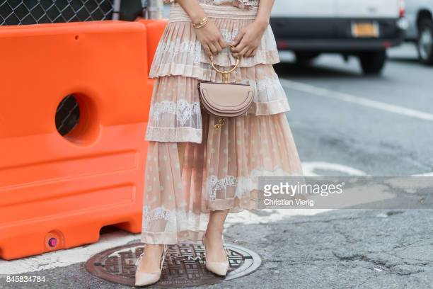 A guest wearing a Chloe bag seen in the streets of Manhattan outside Zimmermann during New York Fashion Week on September 11 2017 in New York City