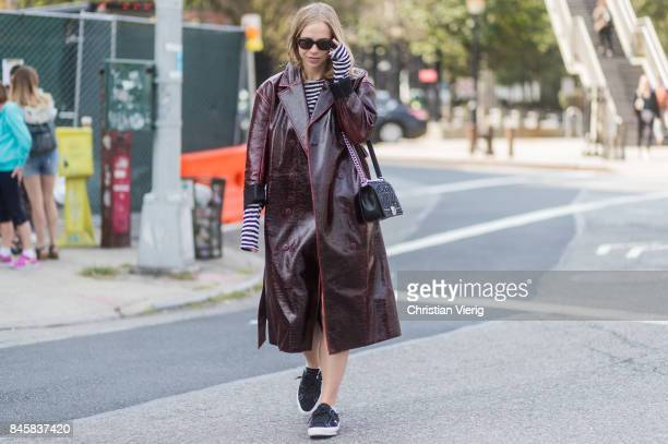 A guest wearing a coat seen in the streets of Manhattan outside Zimmermann during New York Fashion Week on September 11 2017 in New York City