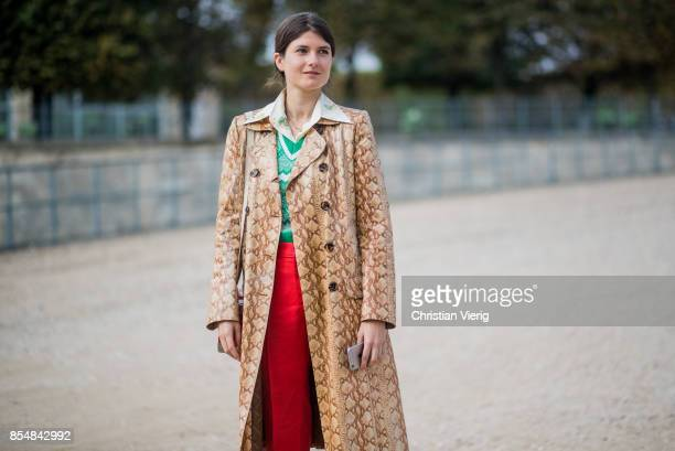 A guest wearing a coat snake print is seen outside Lacoste during Paris Fashion Week Spring/Summer 2018 on September 27 2017 in Paris France