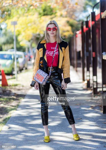A guest wearing a Coca Cola tshirt latex pants Gucci shoes at day 3 during MercedesBenz Fashion Week Resort 18 Collections at Carriageworks on May 16...