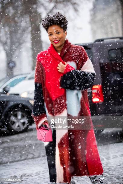Guest, wearing a colorful coat, silver boots and pink Loewe bag, is seen outside Chanel show during Paris Fashion Week - Haute Couture Spring Summer...