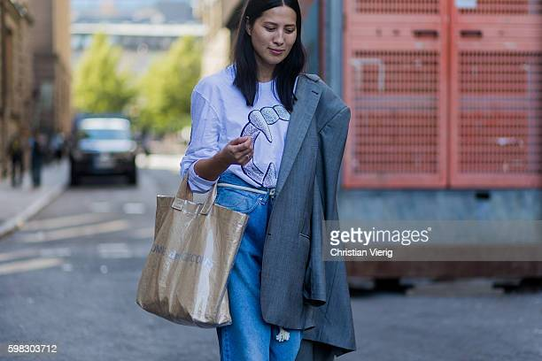 A guest wearing a Comme des Garcons bag outside Nhorm during the third day of the Stockholm Fashion Week Spring/Summer 2017 on August 31 2016 in...