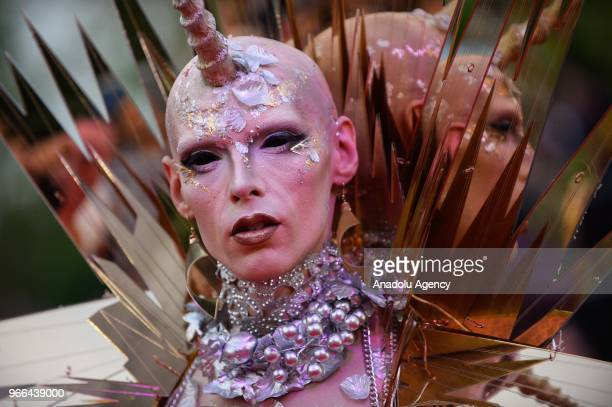 A guest wearing a costume arrives for the 25th Life Ball at Rathaus City Hall in Vienna Austria on June 02 2018 The Life Ball an annual charity event...