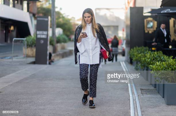 A guest wearing a cropped pants button shirt leather jacket at day 2 during MercedesBenz Fashion Week Resort 18 Collections at Carriageworks on May...