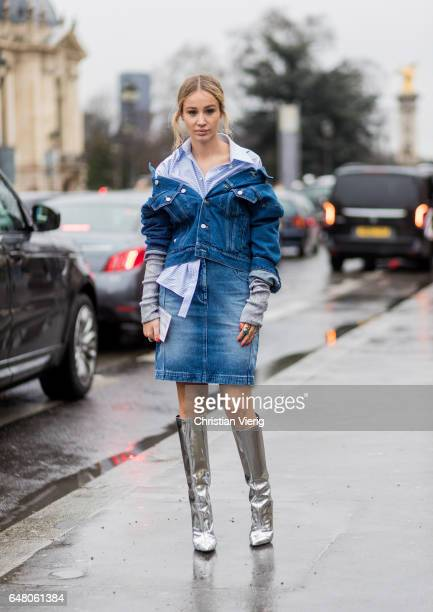 A guest wearing a denim dress and silver boots outside Elie Saab on March 4 2017 in Paris France
