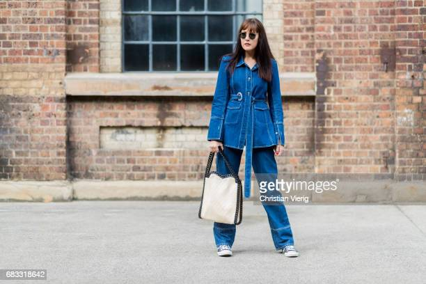 A guest wearing a denim jacket and denim jeans at day 2 during MercedesBenz Fashion Week Resort 18 Collections at Carriageworks on May 15 2017 in...