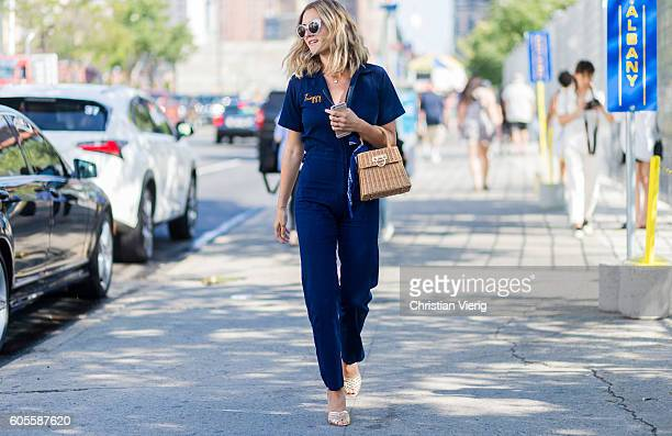A guest wearing a denim overall outside Coach on September 13 2016 in New York City