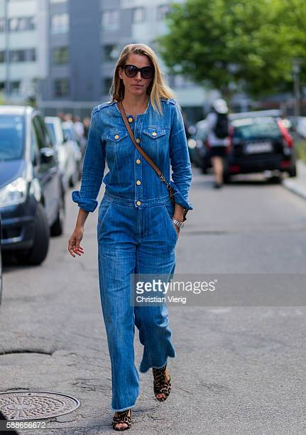 A guest wearing a denim overall outside Ganni during the second day of the Copenhagen Fashion Week Spring/Summer 2017 on August 11 2016 in Copenhagen...