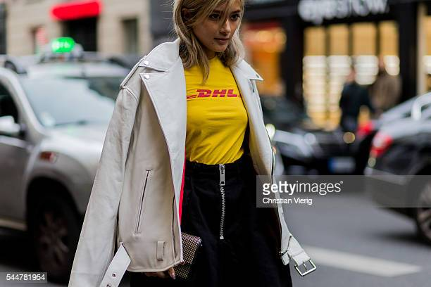 Guest wearing a DHL Vetements tshirt outside Vetements during Paris Fashion Week Haute Couture F/W 2016/2017 on July 3, 2016 in Paris, France.
