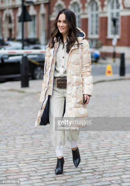 A guest wearing a down feather jacket outside Preen by Thornton Bregazzi on day 3 of the London Fashion Week February 2017 collections on February 19...