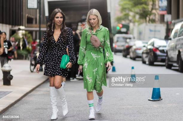 A guest wearing a dress Balenciaga bag white boots and Adi Heyman wearing green dress Gucci belt bag white sneakers socks seen in the streets of...