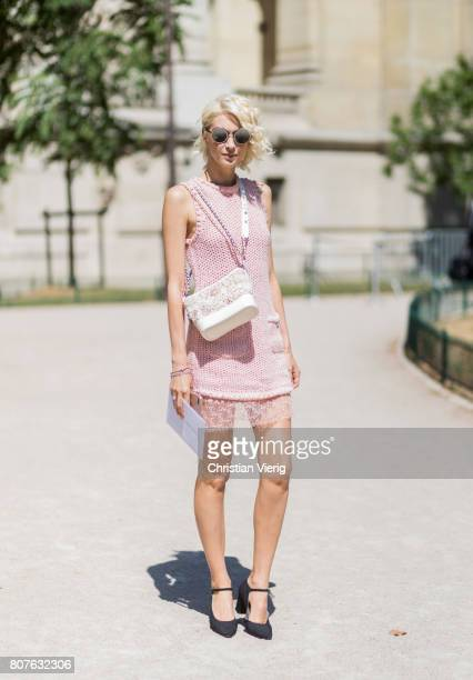 A guest wearing a dress outside Chanel during Paris Fashion Week Haute Couture Fall/Winter 20172018 Day Three on July 4 2017 in Paris France