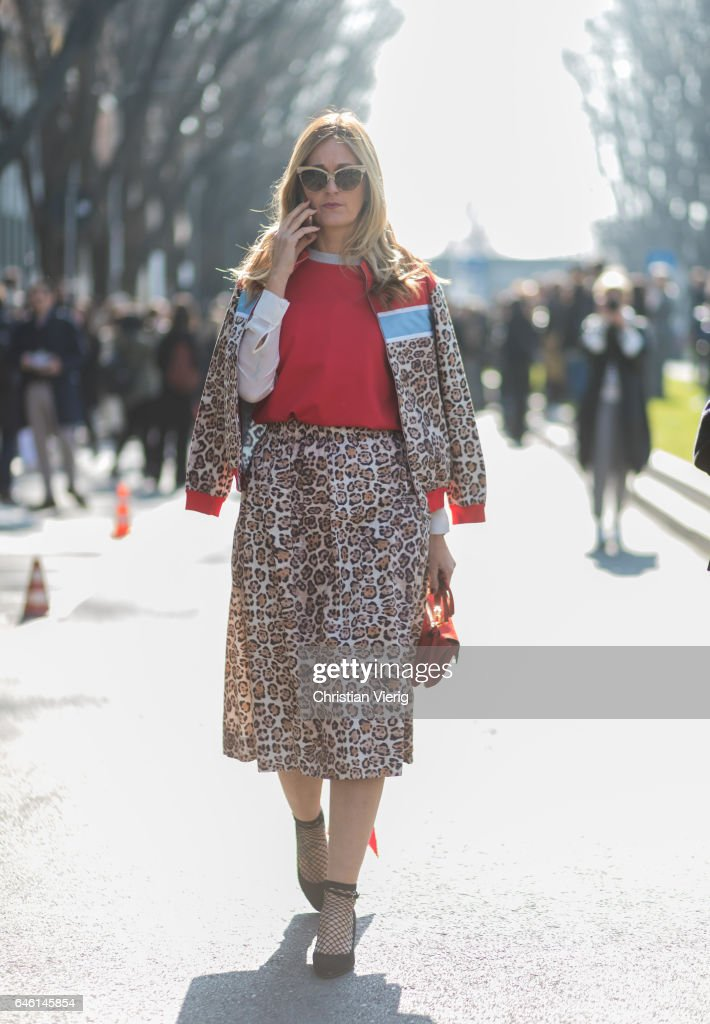 A guest wearing a dress with leo print, net socks, red bag outside Armani during Milan Fashion Week Fall/Winter 2017/18 on February 27, 2017 in Milan, Italy.