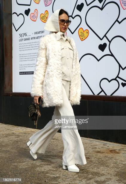 Guest wearing a DVI coat, MVP Wardrobe suit, hat by Rafaello Bettina and bag by Fendi during New York Fashion Week at Spring Studios on February 16,...