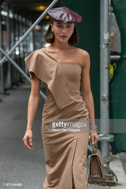 Guest wearing a earth tone dress with matching hand bag and boot attends the Vera Wang show part of New York Fashion Week at the The American Stock...