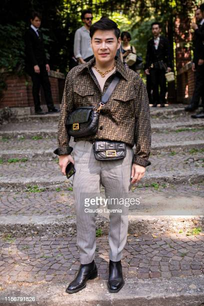 A guest wearing a Fendi shirt cream printed pants black boots black Fendi crossbody bag and fanny pack is seen outside Fendi show during the Milan...