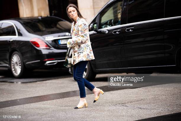 Guest, wearing a floral print blazer, jeans and Chanel heels, is seen outside Giambattista Valli, during Paris Fashion Week - Womenswear Fall/Winter...