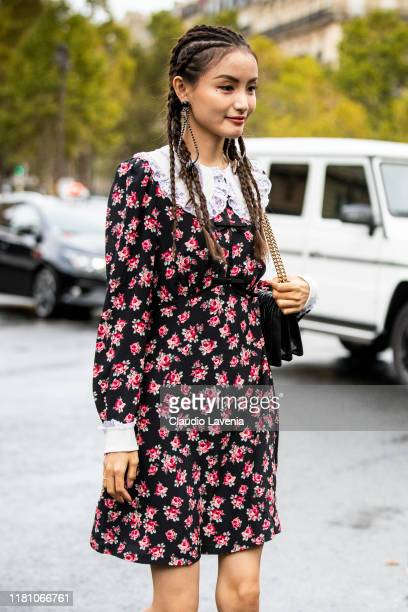 Guest, wearing a floral print mini dress, is seen outside the Miu Miu show during Paris Fashion Week - Womenswear Spring Summer 2020 on October 01,...