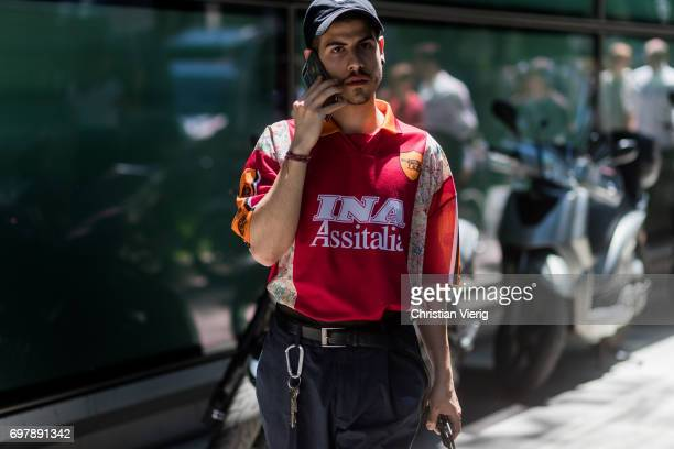 A guest wearing a football tshirt of Totti is seen outside Armani during Milan Men's Fashion Week Spring/Summer 2018 on June 19 2017 in Milan Italy