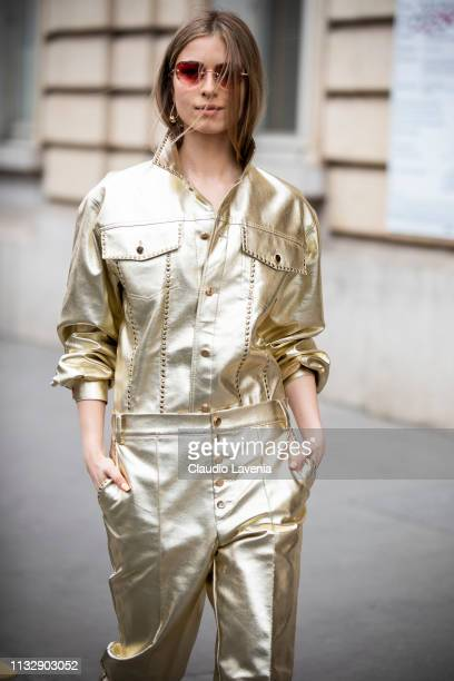 A guest wearing a gold leather shirt with matching pants and blue sandals is seen outside Manish Arora on Day 4 Paris Fashion Week Autumn/Winter...