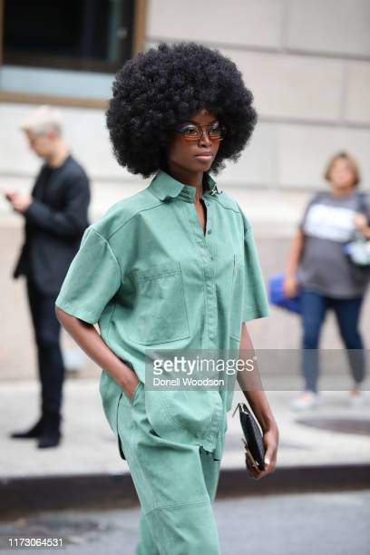 Guest wearing a green outfit during New York Fashion Week at Gotham Hall on September 07, 2019 in New York City.