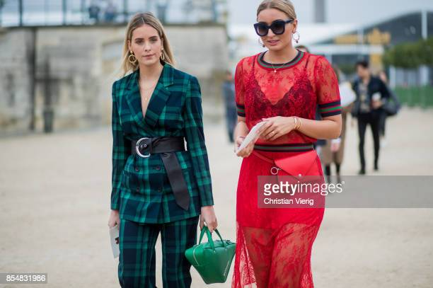 A guest wearing a green suit Balenciaga bag is seen outside Lacoste during Paris Fashion Week Spring/Summer 2018 on September 27 2017 in Paris France