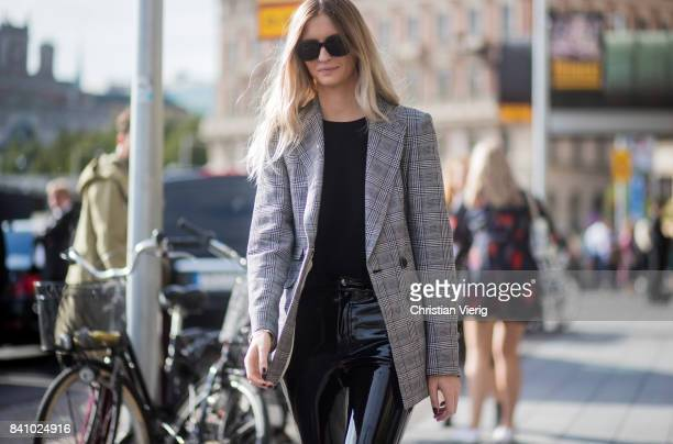 A guest wearing a grey blazer jacket PVC pants outside By Malina on August 30 2017 in Stockholm Sweden