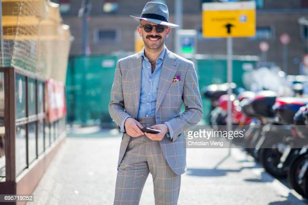 Guest wearing a grey checked suit is seen during Pitti Immagine Uomo 92. At Fortezza Da Basso on June 13, 2017 in Florence, Italy.