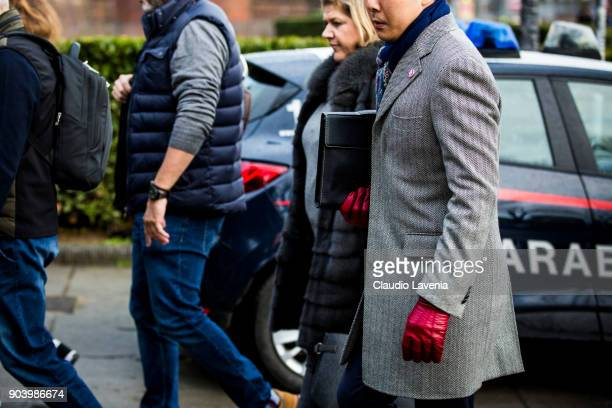 A guest wearing a grey coat is seen during the 93 Pitti Immagine Uomo at Fortezza Da Basso on January 11 2018 in Florence Italy